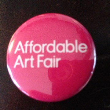 Affordable Art Fair button on brown leather